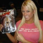 Kelly Kelly shows her action figure.jpg