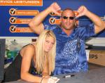 Kelly Kelly signs autograph with RVD.jpg