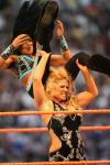 Beth Phoenix throws a fellow wrestler over the top rope.jpg